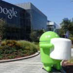 An Android robot holding an oversized marshmallow
