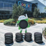 An Android superhero robot with an Oreo cookie on it.